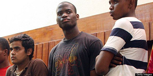 Adebolajo (centre) of Romford, Essex, has been remanded in