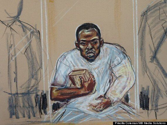 Woolwich Suspect Michael Adebolajo Blows Kisses And Raises Quran In