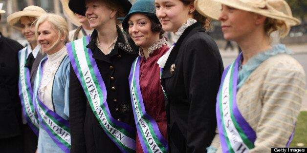 Campaigners dressed as suffragettes attend a rally organised by UK Feminista to call for equal rights...