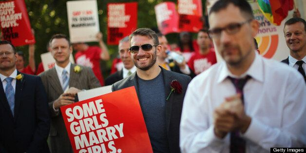 LONDON, ENGLAND - JUNE 03: Proponents of same sex marriage sing during a vigil outside the Houses of...