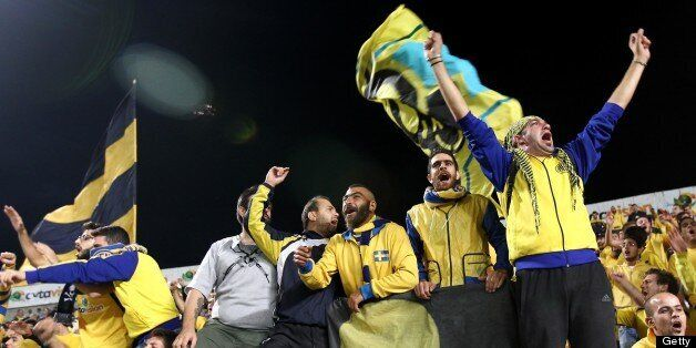 AEL Limassol's fans cheer for their team before the start of the UEFA Europa League group C football...