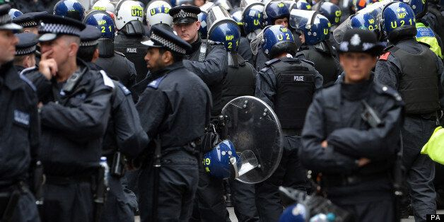 Riot police have lined the streets of central