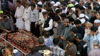 Mourners offer funeral prayers for Syed Areeb Ahmed, a victim of the Christchurch, New Zealand mosque shootings, in Karachi, Pakistan, Monday, March 25, 2019. Ahmed was among nine Pakistanis who were killed on March 15 when a white supremacist shot people inside two mosques. Ahmed was an only son who had immigrated to New Zealand for work, according to his uncle Muhammad Muzaffar Khan. (AP Photo/Fareed Khan)