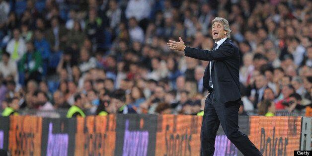 MADRID, SPAIN - MAY 08: Malaga CF head coach Manuel Pellegrini reacts during the La Liga match between...