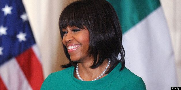 WASHINGTON, DC - MARCH 19: U.S. First lady Michelle Obama smiles during a reception for Ireland's prime...