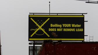 FLINT, MI - FEBRUARY 7:  A sign tells Flint residents that boiling water doesn't remove lead on February 7, 2016 in Flint, Michigan. Months ago the city told citizens they could use tap water if they boiled it first, but now say it must be filtered to remove lead.  (Photo by Sarah Rice/Getty Images)