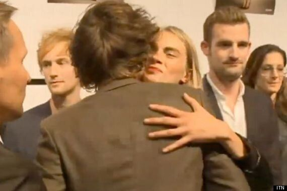 WATCH: Harry Styles Kisses Cara Delevingne After LFW Show, Calls Her 'Amazing'