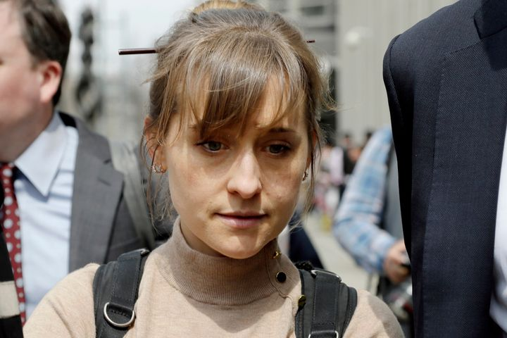 Allison Mack leaves Brooklyn federal court in New York after pleading guilty to racketeering charges in a case involving the