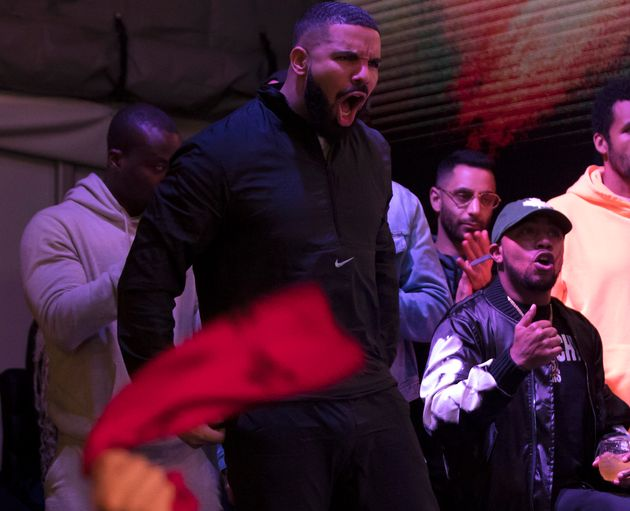 Rapper Drake watches a screen alongside other Toronto Raptors fans for Game 6 of the NBA Finals outside...
