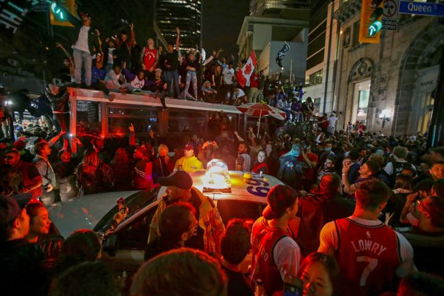 Fans celebrate in the streets of Toronto the Raptors win the NBA championship on June 13,