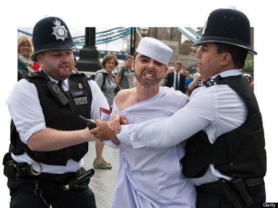 Topless Feminist Protest Against Olympics 'Sharia Law' In London