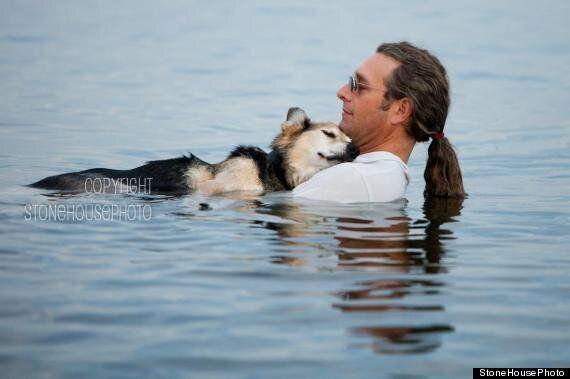 John Unger Cradles Arthritic Dog Schoep In Lake Superior