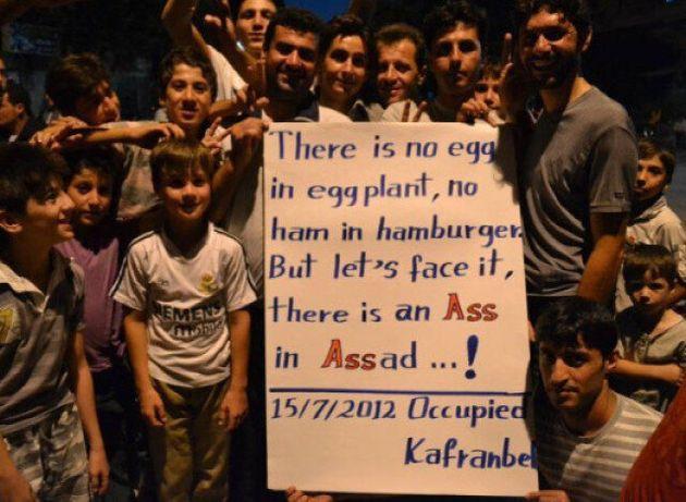 Syria Crisis: 'Occupied Kafranbel' Post Satirical Banners Attacking Bashar Al-Assad