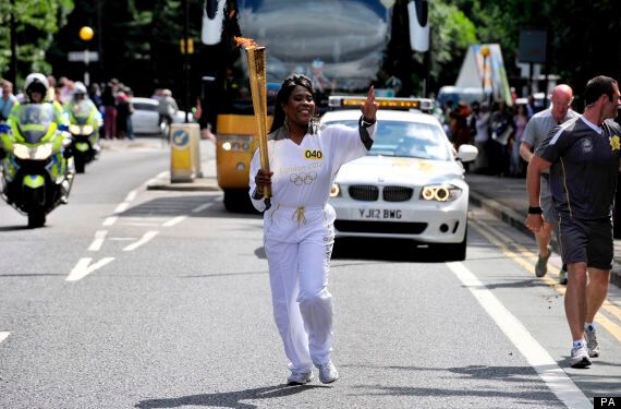 London Olympics 2012: Torch Arrives In Host City, Well-Wishers Line Streets