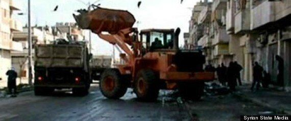 Syria: Atrocities Reported In Ruins Of Baba Amr As Red Cross Wait For
