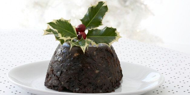 Christmas pudding with holly branch garnishing the top