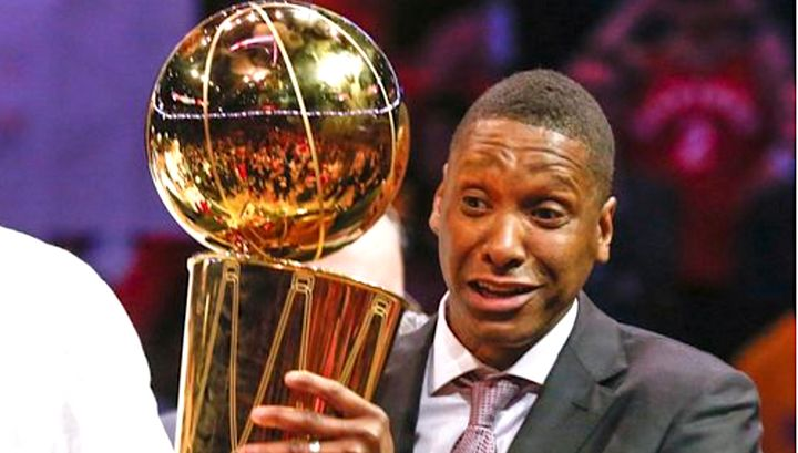 Masai Ujiri is shown holding the trophy after the Raptors won their first NBA championship.