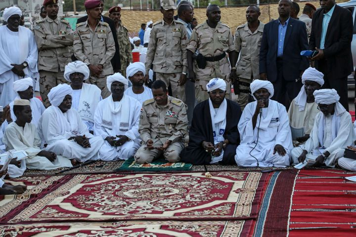 In this file photo from May 18, 2019, Gen. Mohammed Hamdan Dagalo, better known as Hemedti, kneeling center, is the deputy he