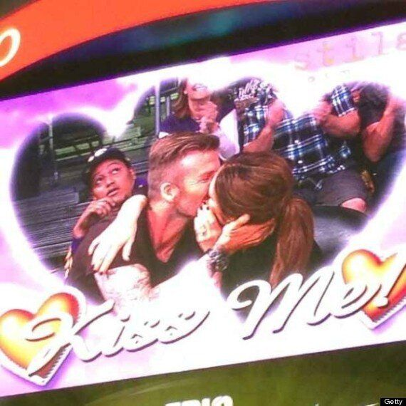 David And Victoria Beckham Share A Kiss On the Big Screen At Basketball Match