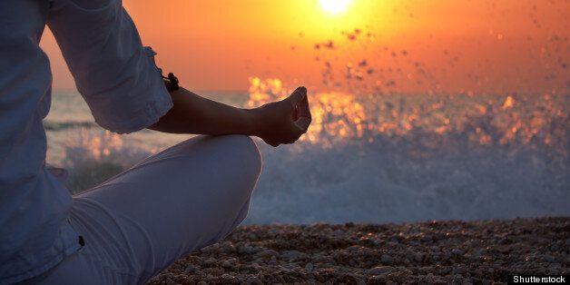 woman practicing yoga near the...