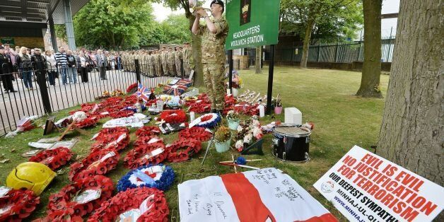 Bugler Dan Griffith plays the last post outside the main gate to Woolwich Barracks in south east London,...