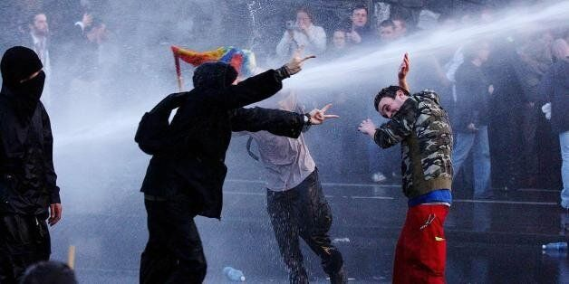 Irish police use water cannon to subdue protesters outside Phoenix Park, where the ceremony for EU enlargement...