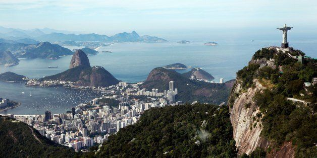 RIO DE JANEIRO, BRAZIL - JULY 07: A general view of the Christ The Redeemer statue atop the Corcovado and Sugarloaf Mountain on July 7, 2014 in Rio de Janeiro, Brazil. (Photo by Jamie Squire/Getty Images)