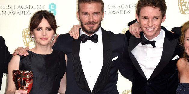 LONDON, ENGLAND - FEBRUARY 08: Presenter David Beckham (C) poses with Felicity Jones (L) and Eddie Redmayne...