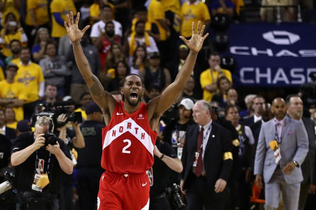 Raptors small forward Kawhi Leonard celebrates after his team defeats the Golden State Warriors in Oakland,...
