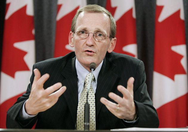 YvesCoteaddresses a news conference in Ottawa on July 18,