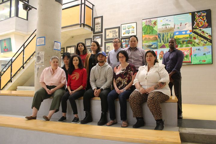 Advocacy Centre for Tenants Ontario staff members, including duty counsels who help tenants fight unfair eviction orders, sit together at Waterfront Neighbourhood Centre in Toronto on June 13, 2019.