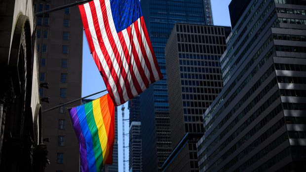 A rainbow flag and a US flag are seen in front of the St Bartholomew's Church on June 11, 2019 in New York City. - In the month of June New York City celebrates  WorldPride on the 50th anniversary of the Stonewall Uprising. (Photo by Johannes EISELE / AFP)        (Photo credit should read JOHANNES EISELE/AFP/Getty Images)