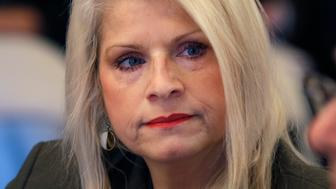 FILE - In this Wednesday, Jan. 28, 2015, file photo, Sen. Linda Collins-Smith, R-Pocahontas, listens to testimony at a meeting of the Senate Committee on Public Health, Welfare and Labor at the Arkansas state Capitol in Little Rock, Ark. Authorities on Friday, June 14, 2019, said they've arrested an Arkansas woman in connection with the killing of former state Sen. Linda Collins-Smith, who was found dead outside her own home, on June 4. (AP Photo/Danny Johnston, File)