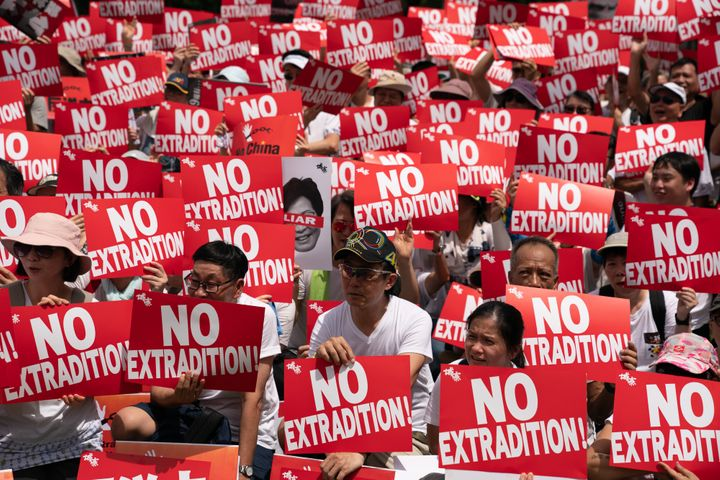 Protesters hold placards and shout slogans during a rally against the extradition law proposal on June 9, 2019.Hong Kon