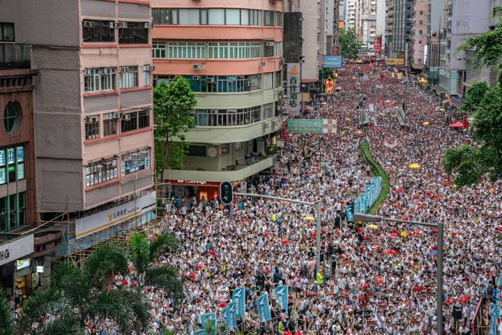 Protesters march on a street during a rally against a controversial extradition law proposal on June 9, 2019 in Hong Kong. Or