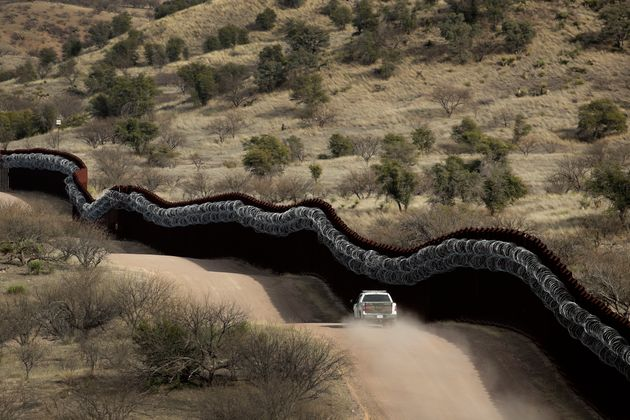 This March 2, 2019, file photo, shows a Customs and Border Control agent patrolling on the US side of...