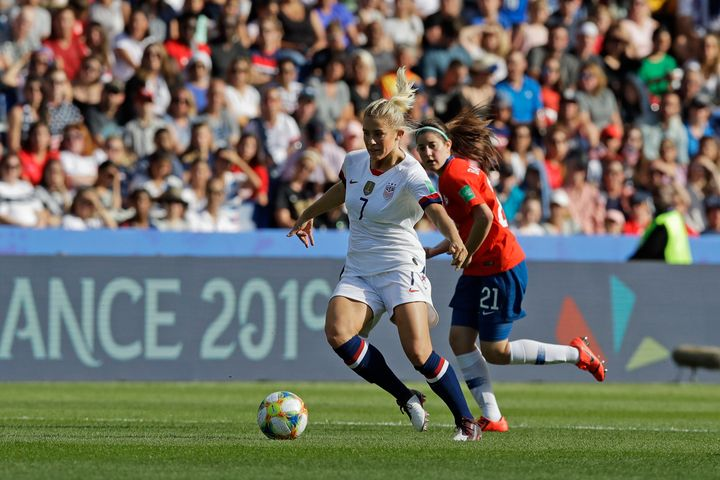 United States' Abby Dahlkemper, left, runs with the ball past Chile's Rosario Balmaceda during the Women's World Cup Group F