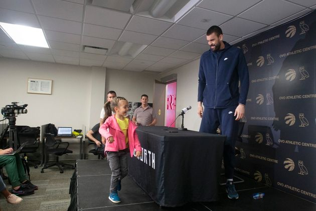 After Marc Gasol was finished speaking to reporters on Sunday, his daughter, Julia, jumped up on the...
