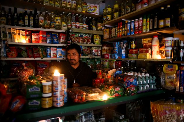 Vendor waits for customers during a national blackout, in Buenos Aires, Argentina 16 June