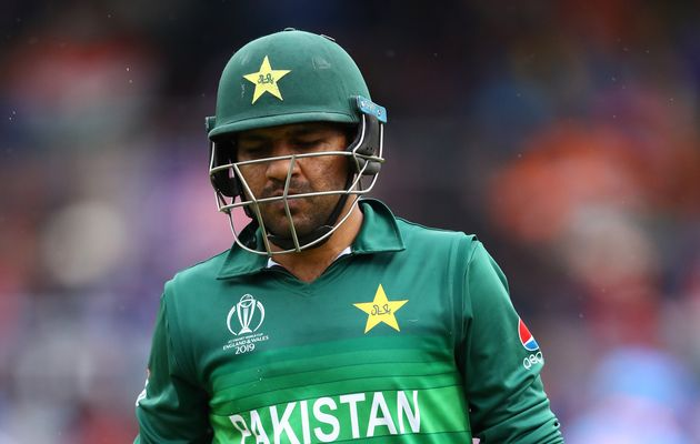 Pakistan captain Sarfaraz Ahmed walks off after being bowled by India's Vijay