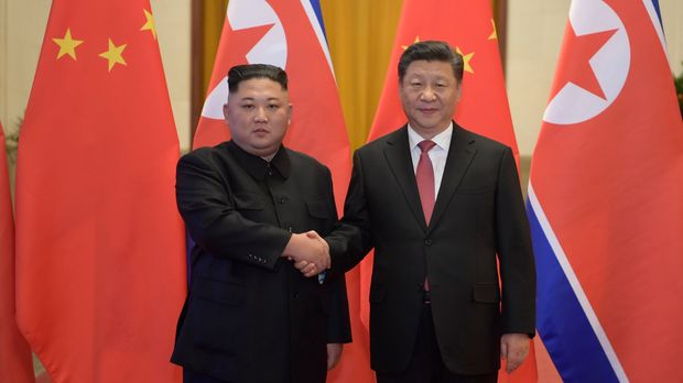 In this Tuesday, Jan. 8, 2019, photo released by China's Xinhua News Agency, North Korean leader Kim Jong Un, left, and Chinese President Xi Jinping shake hands as they pose for a photo before talks at the Great Hall of the People in Beijing. A special train believed to be carrying Kim Jong Un departed Beijing on Wednesday after a two-day visit by the North Korean leader to the Chinese capital. (Li Xueren/Xinhua via AP)