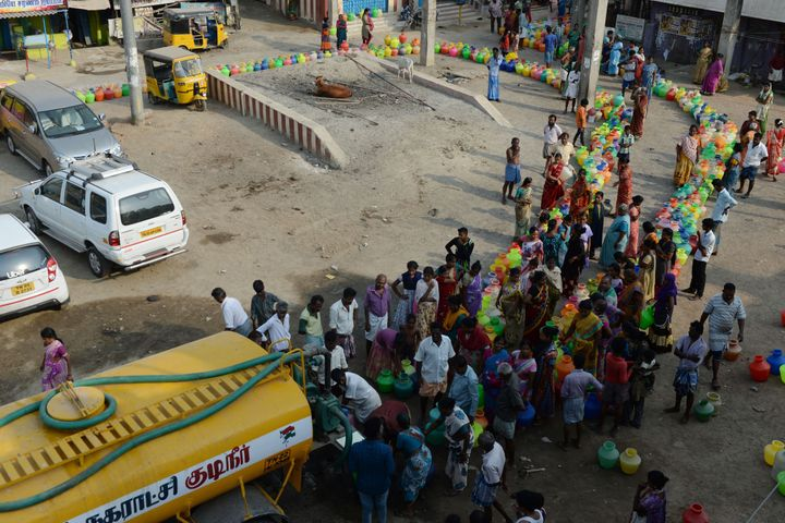 People queue to get drinking water from a tanker on the outskirts of Chennai.