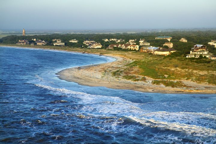 An 8-year-old boy was swimming off North Carolina's Bald Head Island on Sunday when he was bitten on his leg.