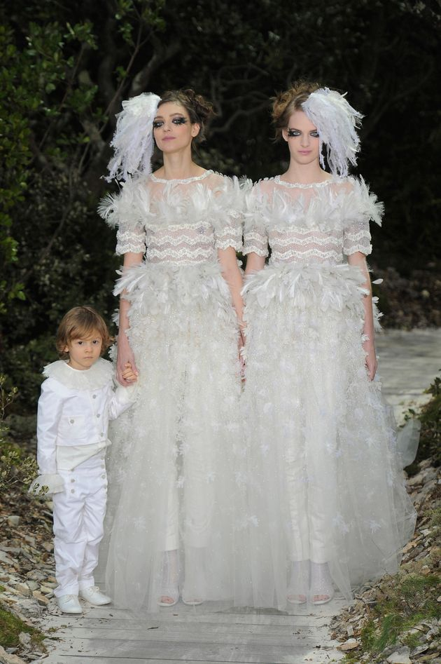 Models Ashleigh Good and Kati Nescher close the spring 2013 Chanel couture show in
