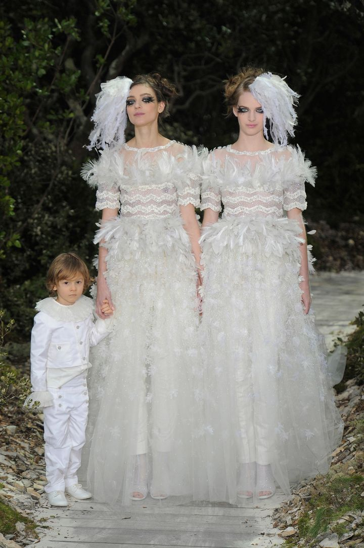 Models Ashleigh Good and Kati Nescher close the spring 2013 Chanel couture show in Paris.
