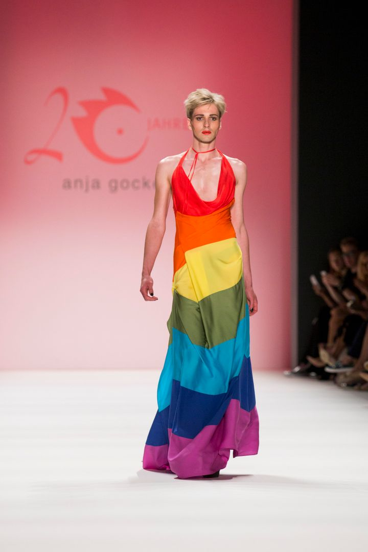 A model wears a rainbow flag dress as he walks the runway at the Anja Gockel show during the spring.summer 2017 Mercedes-Benz Fashion Week in Berlin on June 29, 2016.