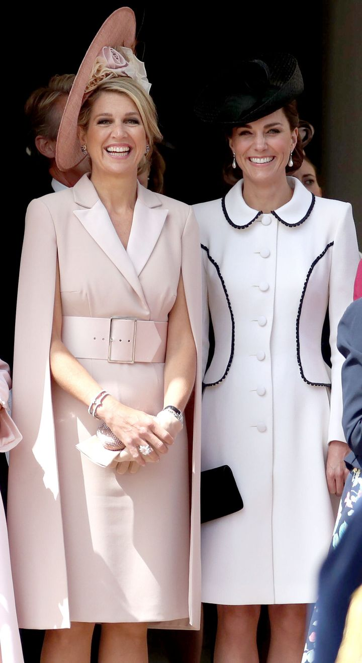 The Netherlands' Queen Maxima and Catherine, Duchess of Cambridge watch the procession to St. George's Chapel.