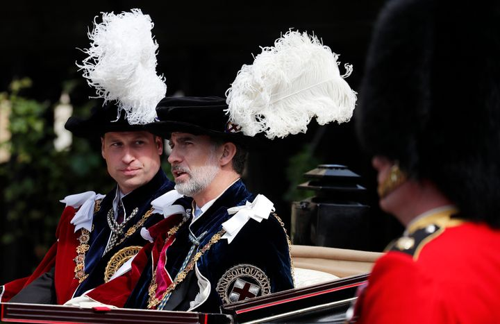 Prince William and Spain's King Felipe sit in a carriage after the Order of the Garter service.