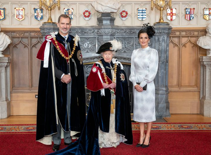 Queen Elizabeth poses for a picture with Spain's King Felipe VI and Queen Letizia in St. George's Hall on June 17 after the k