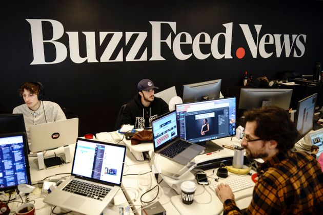 Members of the BuzzFeed News team work at their desks at BuzzFeed headquarters in New York. Employees...
